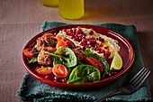 Falafel with hummus and pomegranate seeds