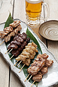 Yakatori skewers with a beer