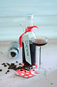 Coffee liqueur in a bottle and a glass for gifting