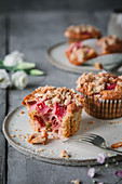 Rhubarb muffins with almonds and streusel topping