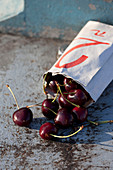 Cherries cascading out of a bag