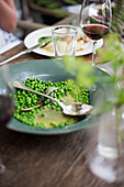 Garden peas in a bowl out on a table