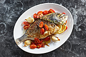 Whole bream with cherry tomatoes