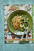 Courgette fritters with a courgette ribbon salad with toasted almonds and pumkin seeds