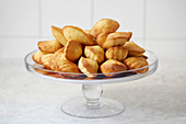 Madelines stacked on a cake stand
