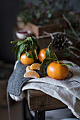 Small Mandarin oranges with branches on a table