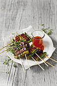 Beef and green asparagus skewers