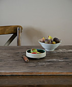 Fresh figs in bowls on a wooden table