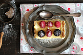 Mille feuille with berries and powdered sugar