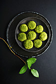 Overhead image of matcha cookies covered with sugar and matcha powder (Matcha snickerdoodles)