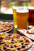 Pizza and beer on a restaurant table