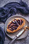 Toast with peanut butter and blueberry jam