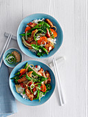 Wok chicken with colourful vegetables and rice