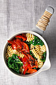Kale pasta with peppers and chorizo