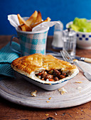 Steak and kidney pie with chips (England)
