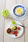 Crab cakes with tomato sauce and avocado dip
