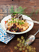 Einkorn Risotto with mushrooms and fresh herbs (ancient grain)