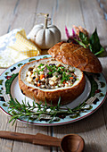 Beef and barley soup with mushrooms in bread bowl