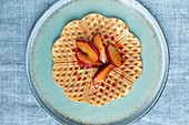 Rice waffles with plums