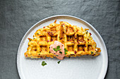 Gluten-free potato and herb waffles with ham