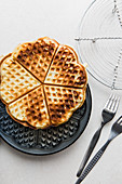 A waffle being removed from a waffle iron