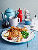 Breaded fish with peas and chips