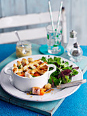 Chicken and ham pie with mixed salad leaves