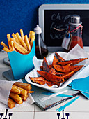 French fries and sweet potato wedges in a restaurant