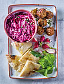Beetroot tzatziki with pitas and falafel