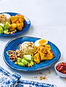 Nasi Lemak, Kokosreis mit Hühnercurry und Sambal (Malaysia)