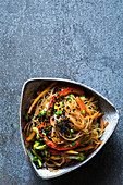 Oriental glass noodle salad with vegetables and black caraway