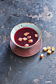 Elderberry soup with sweet cinnamon croutons