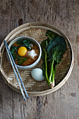 Miso soup with grated radish, spinach and egg