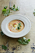 Corn chowder with sour cream and pepper oil