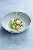 Delicate spring vegetables in a fine chervil nage
