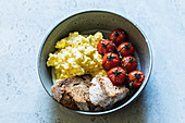 Scrambled eggs with oven-roasted tomatoes