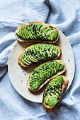 Grilled bread topped with avocado and lemon