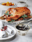Roast stuffed goose plated with roast potaties red cabbage and stuffing with prunes in Armagnac