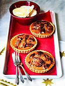 Mini pecan tarts for Christmas with vanilla sauce