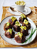 Salt crusted mini jacket potatoes with cold chive hollandause sauce