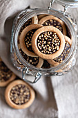 Cookies with chocolate and hazelnut crumbs in a glass jar