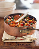 Pasta with tomato, herbs and olives