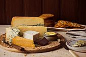 A cheese platter with butter and crackers
