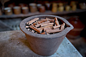 Cinnamon quills in an antique stonewear bowl