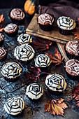 Cobweb cakes for Halloween with mini pumpkins