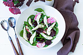 Pear and beetroot salad with spinach and a vinaigrette dressing