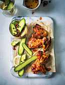 Sticky chicken wings with peppery cucumber pickle
