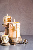 Dripping white chocolate 'candle' cakes with eggnog sponge and nutmeg-rum buttercream icing