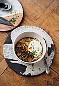 Oat porridge with fried mushrooms and egg