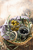 Green and black cerignola olives in jars
